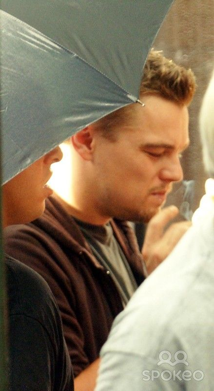 Leonardo DiCaprio has a cigarette break and gets cooled down by his assistant who holding a hand size fan on the set of his latest movie 'The Departed' New York City, USA- 12.07.06 **Not Available for publication for New York's Daily Newspapers. Available for publication in the Rest of the World**