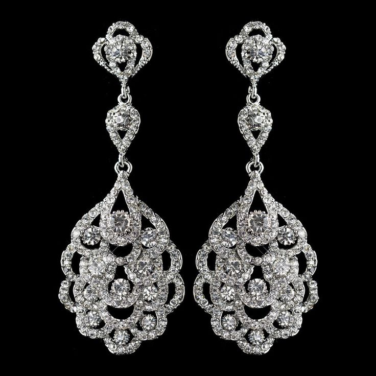 These beautiful rhodium silver clear crystal chandelier earrings are ideal for weddings, proms, homecomings, or any other elegant affair! They feature rhodium plated design adorned with dazzling clear