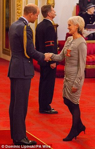Judy Murray, 58, was presented with her OBE by Prince William at Buckingham Palace today...