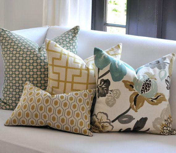 love the colors. the bold patterns are fun too, even though i don't know if i am bold enough to actually purchase/make pillows this bold.