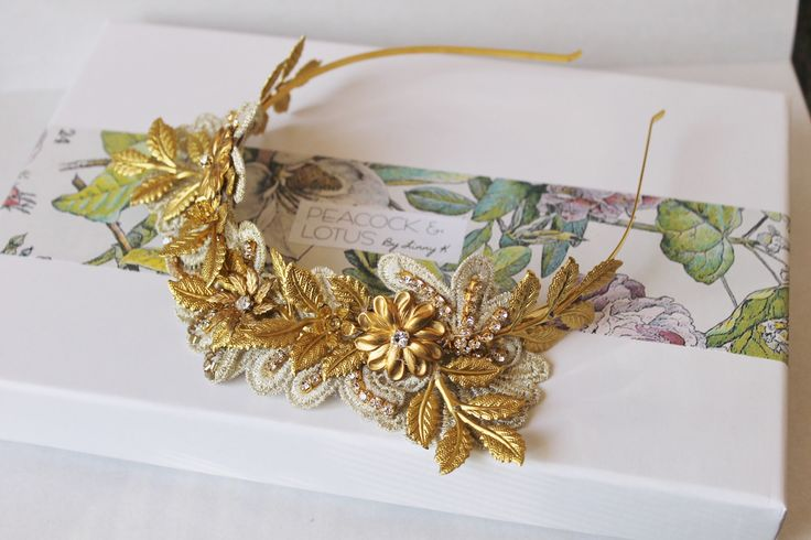 Gorgeous gold tone brass leaf & lace wedding headband crown tiaraAdorned with multiple brass leaves, branches & brass flowers this headpiece has quite the Edwardian feel to it. The gold lace adds a lovely feminine feel to the crown.Perfect for a bride looking for a statement headpiece which exudes the elegance and grace of yesteryear.Headband thickness Measure 3mm - gold-platedThe fine details- Handcrafted by Linny K in her studio in Canberra, Australia- Headband thickness measures 3mm…