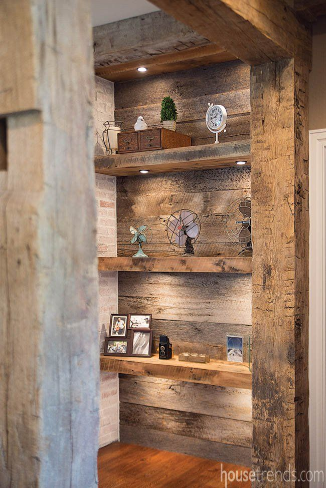 Scars in the recycled oak beams in this home hint at their 150 years of use in a local barn.