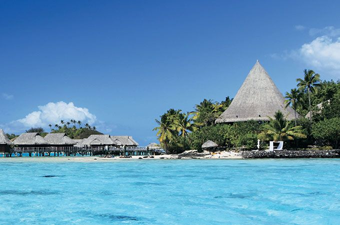 Tahiti's famous azure waters and romantic thatched villas