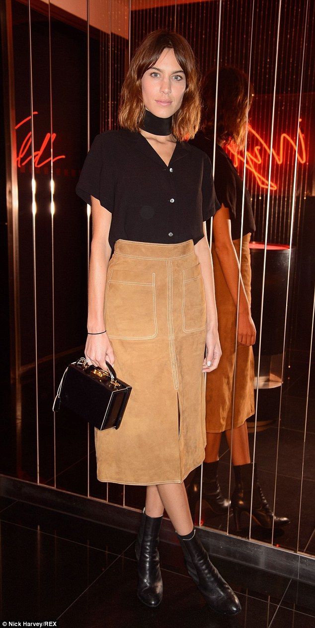 Stylish in suede: Alexa Chung looked seriously chic in a midi skirt with black accessories as she attended the W Beijing - Chang'an party at the W hotel in London on Thursday night