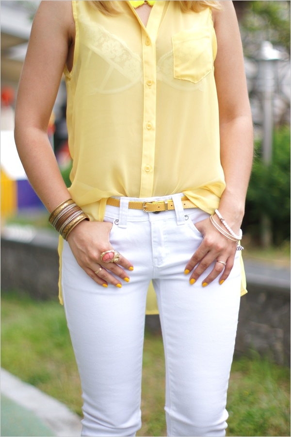 yellow blouse and white pants