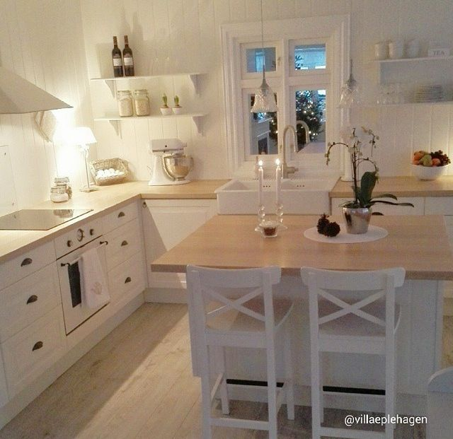 Nice stools(IKEA). Also nice example of stove cooktop integrated into cabinets. Small island possible?