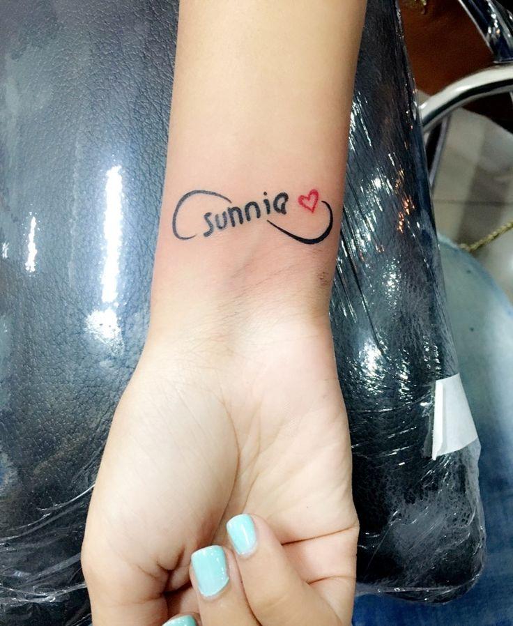 Handwritten name tattoo in infinity