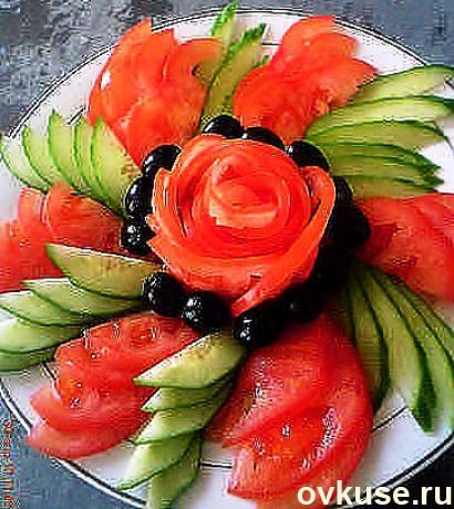 Presentation of cucumbers, tomatoes, olives, maybe red bell pepper  ALSO SEE DIPS