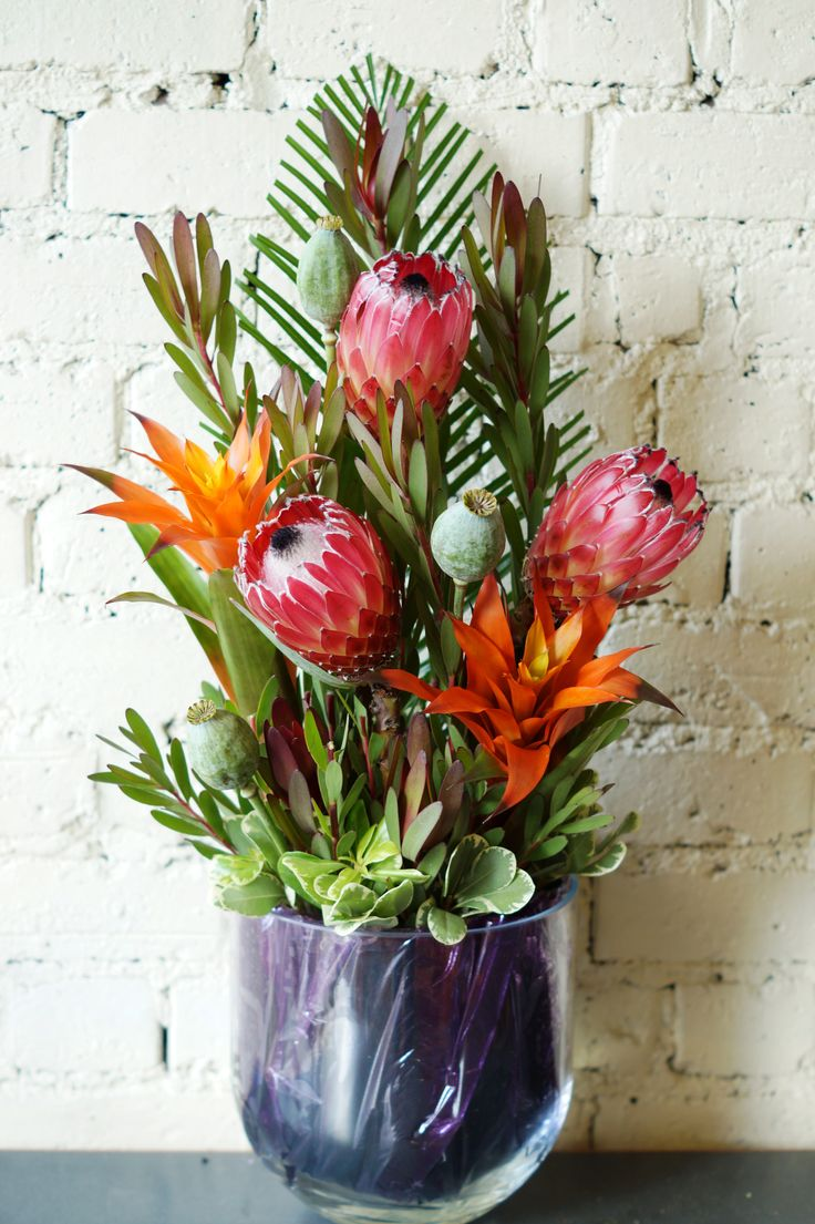 The main flowers used are orange Bromeliads