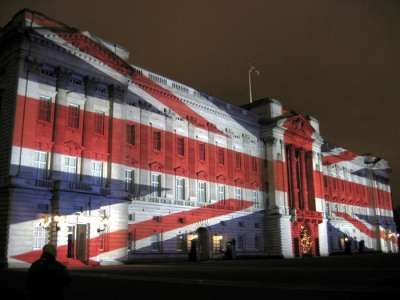 Buckingham Palace with the Union Jack projected onto it for Christmas Eve 2003