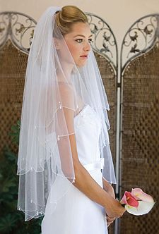 """791-This pretty, two tiered, fingertip length veil (30x36), has a scalloped bead edge with pearl drops and rhinestone accents. It is circular cut and 72"""" wide on a satin comb. It is available in either white or ivory.   In Stock in White & Ivory.  Ships within 2 business days from order date, regardless of the shipping method chosen.   Customize your veil by adding Shimmer Veiling or adding scattered pearls or rhinestones.  For all available colors, see """"Color Options"""" above.   Please all..."""