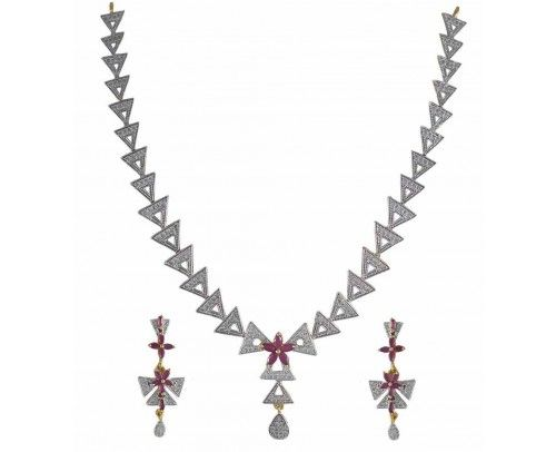 A classic necklace from REJEWEL is made of American Diamonds.Unique intricating triangle motif design throughout the set makes it a show stealer.The centre CZ Ruby Flower gives a more feminine touch to the set.A matching pair of earring along give the complete stunner look to you when worn with any Indian or western outfit.
