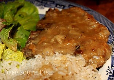 """Deep South Dish: Country Style Pork Chops in Gravy...""""Bone-in pork chops, dredged in seasoned flour, pan fried and finished in gravy."""""""