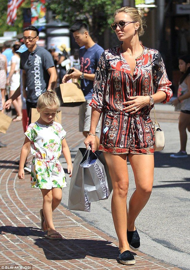 Like mother, like daughter! Alex Gerrard's youngest daughter, Lourdes, looked the spitting image of her glamorous mother as they enjoyed a shopping trip together, on Tuesday