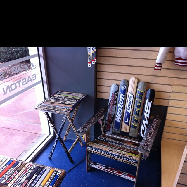 Chair And Side Table Made Out Of Hockey And Goalie Sticks