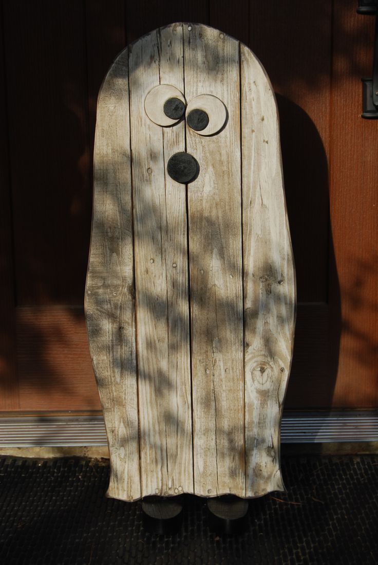 "Scary Ghost made from pallet wood. Has little black shoes, too. ""Who you gonna call...?"""