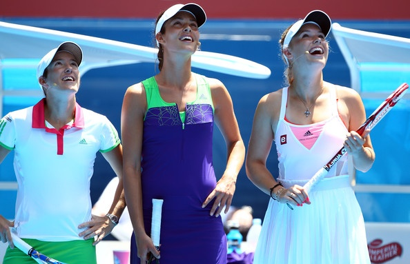 """With fellow players, Justine Henin (France) & Carolinie Wozniacki (Denmark) participating in the 2011 Australian Open - """"Rally For Relief"""" Charity Exhibition, January, 2011"""