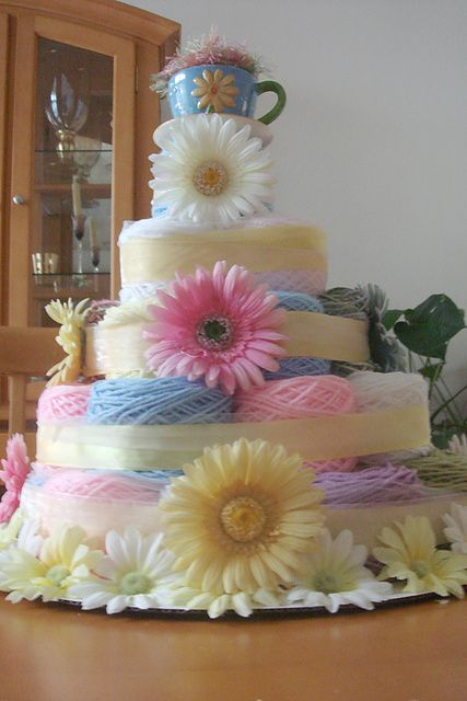OK, this is a yarn cake. I created it for a client who wanted a centerpiece for a retirement party.