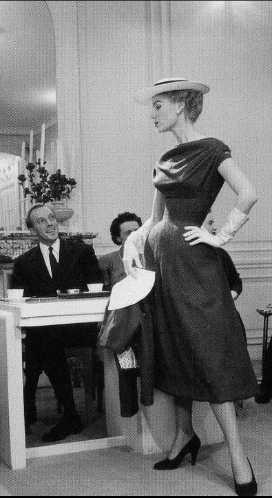 1951 Stella models a day dress from the Spring Collection as a pleased Jacques Fath looks on, photo by Willy Maywald,