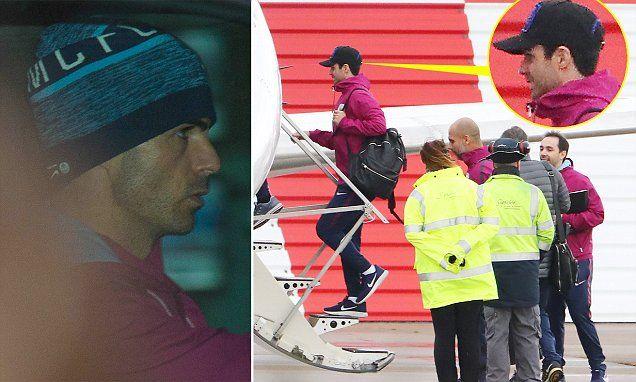 Man City's Mikel Arteta wears hat to hide forehead cut