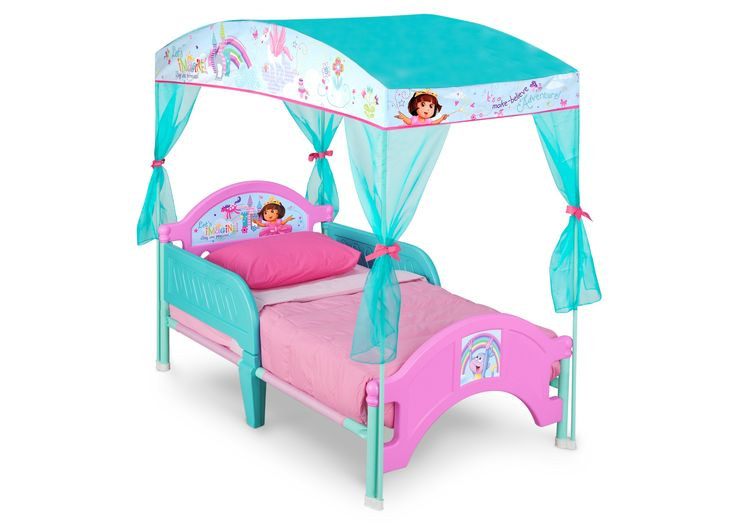 Make her space extra special with Delta Children Dora The Explorer Pink  Toddler Canopy Bed featuring colorful decals of Dora and her BFF Boots at  the ...