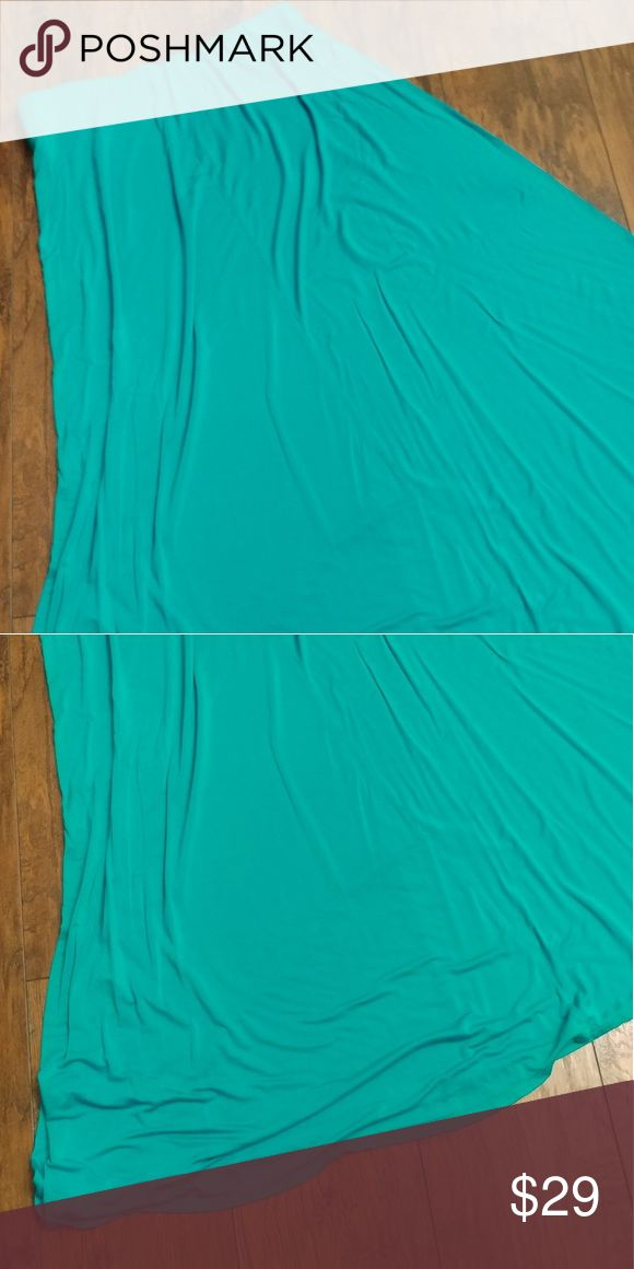 Turquoise Maxi Skirt Maxi skirt that is long and flowy. Super soft material, 96% poly, 4% spandex. Elastic band at waist that lays flat and has stretch. Size 14/16. Lane Bryant Skirts Maxi