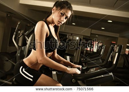 beautiful woman at the gym and smiling - stock photo