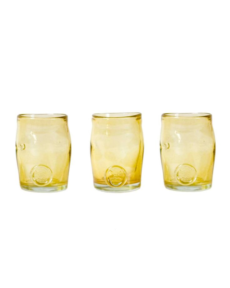 Three glasses set-golden yellow Crafted by hand, this stunning glasses set feature a classic design and colored finish that may vary slightly between products. Perfect for serving individual desserts at dinner parties or drinks in the garden.