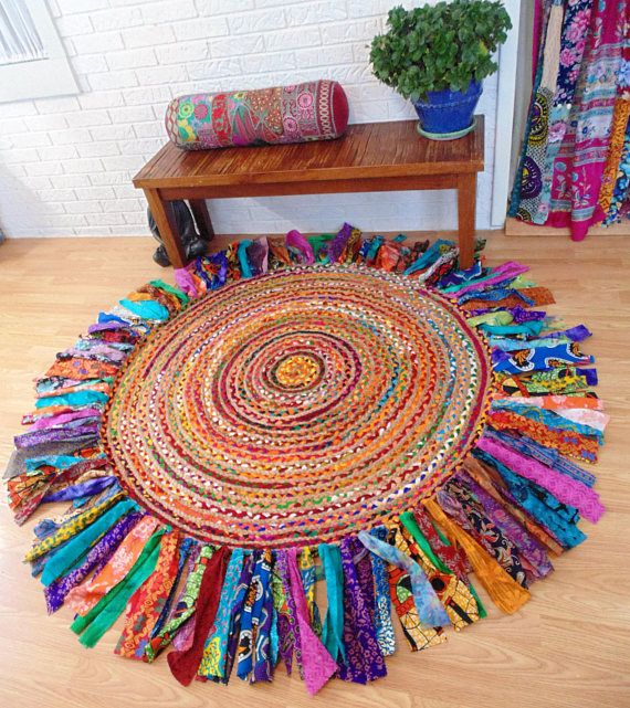 EYE CATCHING!!! Brand New braided jute/cotton rug from INDIA has been upcycled and with VINTAGE, HIPPIE, RETRO and Bright ETHNIC fabrics that are woven into the rug. Fabrics are vintage, tie dye, African wax prints, batiks, metallic prints etc.-very durable fabric. There are no