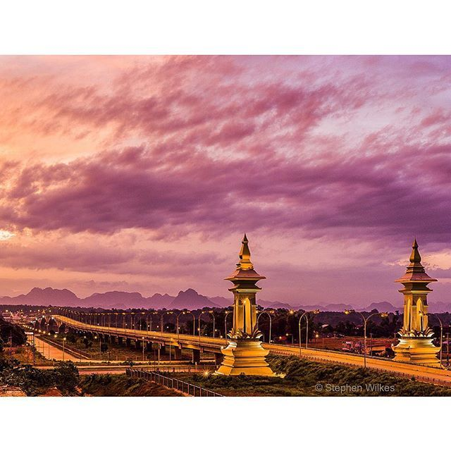Photo by @stephenwilkes: The Friendship Bridge at Thakhek links Laos to Thailand a fellow Buddhist Nation. The bridge opened in 2011 and is one of four Thai-Lao friendship bridges build over the Mekong River since 1994.  It was a pleasure to travel to such an incredible country that has overcome so much. Find more on life in Laos since the Vietnam War by reading the story in the August issue of National Geographic. (link to the story in my profile)  #Laos #NatGeo #FriendshipBridge #Sunset by…
