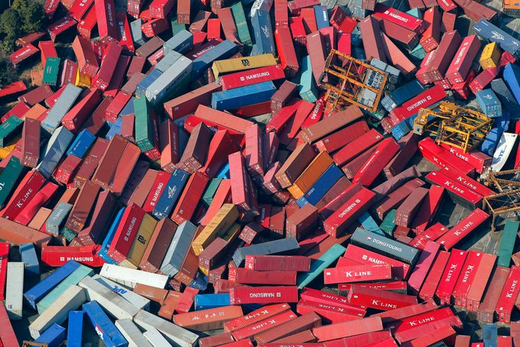 Cargo containers are strewn about in Sendai Japan March 12. Japan launched a massive military rescue operation Saturday after a giant, earthquake-fed tsunami killed hundreds of people and turned the northeastern coast into a swampy wasteland, while authorities braced for a possible meltdown at a nuclear reactor. (Itsuo Inouye/Asociated Press) #