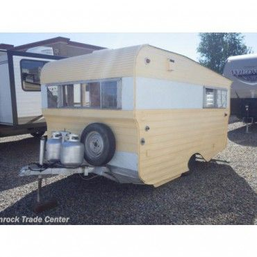 Didn't you mother tell you to never judge a book by its cover? Make sure you heed her advice when you check out our Throwback Thursday Vintage RV, this 1964 Vintage Travel Trailer. While it may appear cute and small on the outside, this used travel trailer is surprisingly spacious. This charming RV has a kitchen with a stove and oven, as well as an icebox. With 14ft of length, this travel trailer has enough seating and space to sleep two people.    This little trailer would be perfect for…