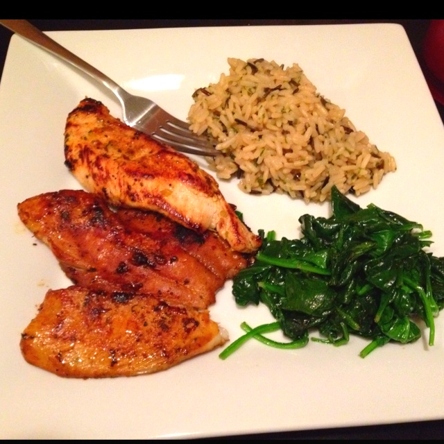 Caribbean jerk tilapia and chicken, wild rice, steamed spinach.