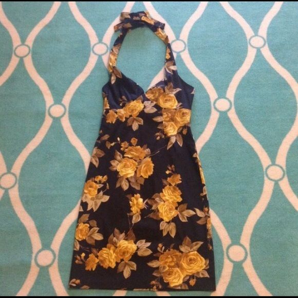 Cute Midi Summer Dress I love this yellow flowered halter dress. It's perfect for summer & has a midi length. Really cute neckline too. It's be perfect for work with a cardigan too! Dresses