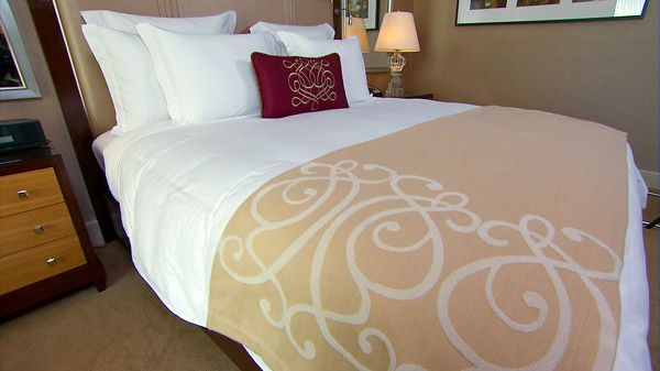 How To Make A Hotel Bed | Steven and Chris | Ever wonder how hotel beds look so perfect? Andrew Leech, Director of Housekeeping at The Ritz-Carlton gives us his insider secrets on how to make a hotel bed. Download ( 'http://get.adobe.com/flashplayer/