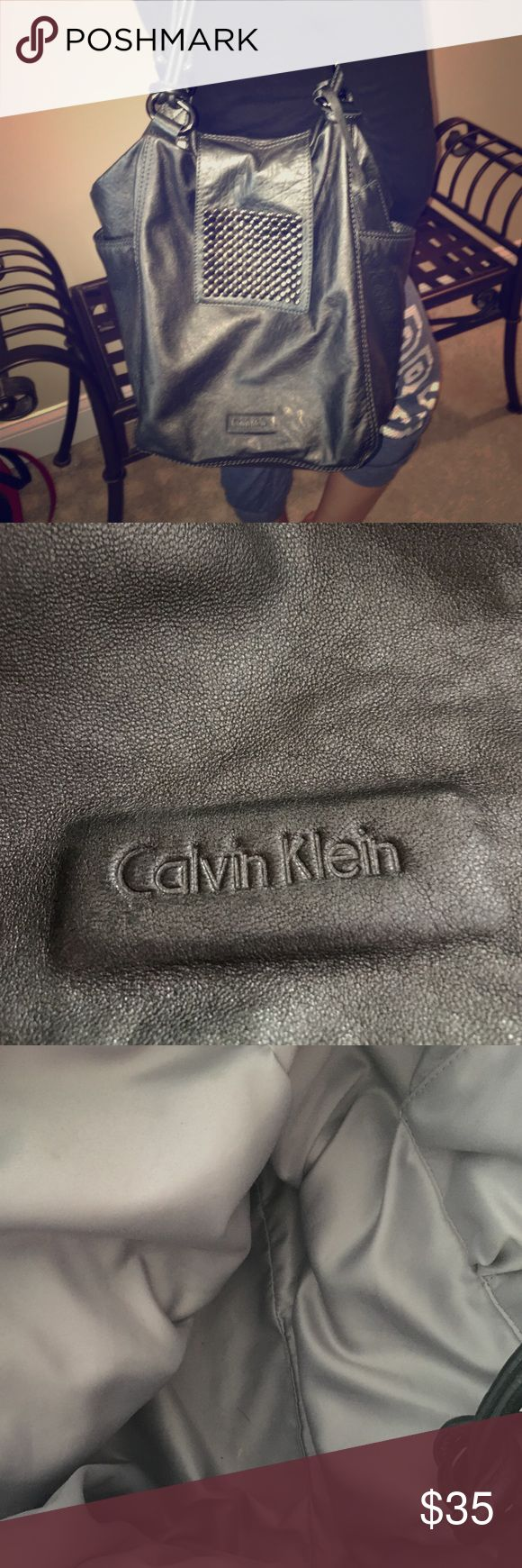 Platinum Calvin Klein Bag with Studs. Large Large bag. (Not quite as big as picture makes it look). Has side pockets and is extremely soft with lots of give. A couple of small spots on bottom. Priced accordingly. Calvin Klein Bags Hobos