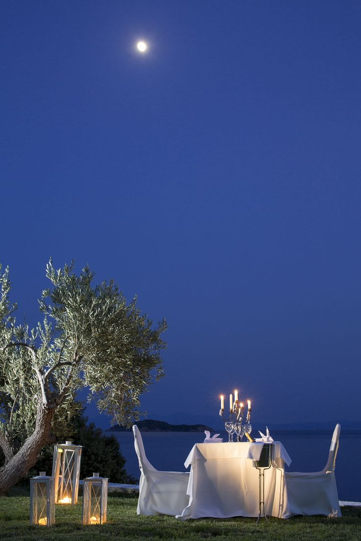 Candle light dinner table for two - Candlelight Dinner For Two With The Moon Mirrored On The Deep Blue Waters Of