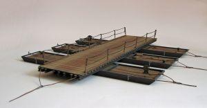 """Model promu, barki, ogniwa mostu przeprawowego z okresu II wojny światowej, konstrukcji polskiej/radzieckiej. Model zbudowany od podstaw, zawierający elementy plastikowe, drewniane, tekturowe i inne, ręcznie złożony i pomalowany w skali 1:35. Wymiary: długość (""""od deski do deski"""") 44 cm, szerokość 35cm.""""Ferry, barge, bridge"""" (012015) - this is model ferry, barge, link bridge of World War II, construction Polish/Soviet. Model built from scratch, containing plastics, wood, cardboard and other…"""