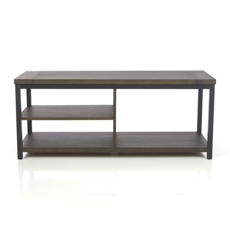 Clean, open, uncluttered housing shows off media in a modern mix of charcoal-stained wood veneer and metal.  Off center shelves park media components next to a large open space just right for storage.  With the strength of a metal frame and the rich, warm character of hardwood grain, this versatile piece doubles as a bench or low console. Metal frameSolid wood, wood veneer and eco-friendly engineered wood with charcoal stainDust with soft dry clothMade in Indonesia.