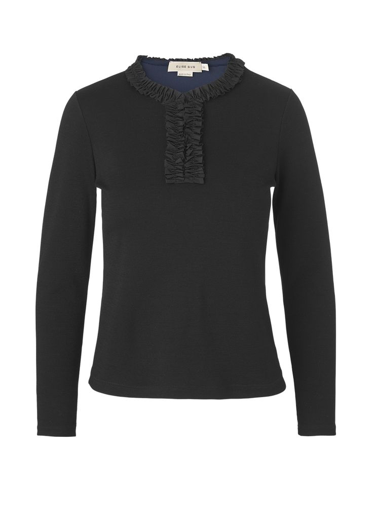 Blouse in wool jersey with ruffles in the neckline and down the front. The front is kept closed with two hooks which can be open if wanted. mo. 1021 darfo