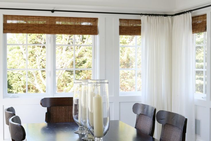 Pretty Bamboo Shades Beneath White Sheer Curtains In This