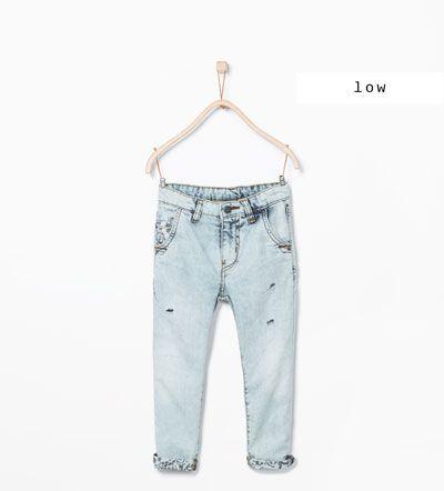 Pantaloni denim dettaglio tagli