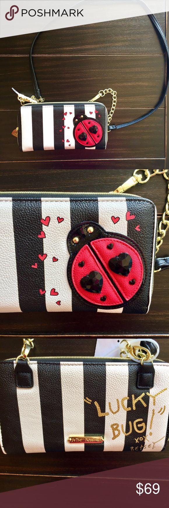 "Betsey Johnson Ladybug Wallet on String Crossbody Betsey Johnson Ladybug Wallet on a String Crossbody Bag - Unique Design features ID Window, Zippered middle Compartment, 12 Credit Card Slots and 2 slip pockets. Gorgeous stripes and ladybug with studs and jewel embellishments.    Wallet with Removable Crossbody Strap Zip-around closure with signature logo heart-shaped zipper pull  Exterior Rear is written in metallic gold, ""Lucky Bug!"" and ""xox Betsey"" Removable partial chain crossbody…"