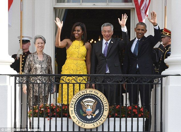 President Obama and Prime Minister Loong wave with their wives Mrs. Lee Hsien Loong (L) an...