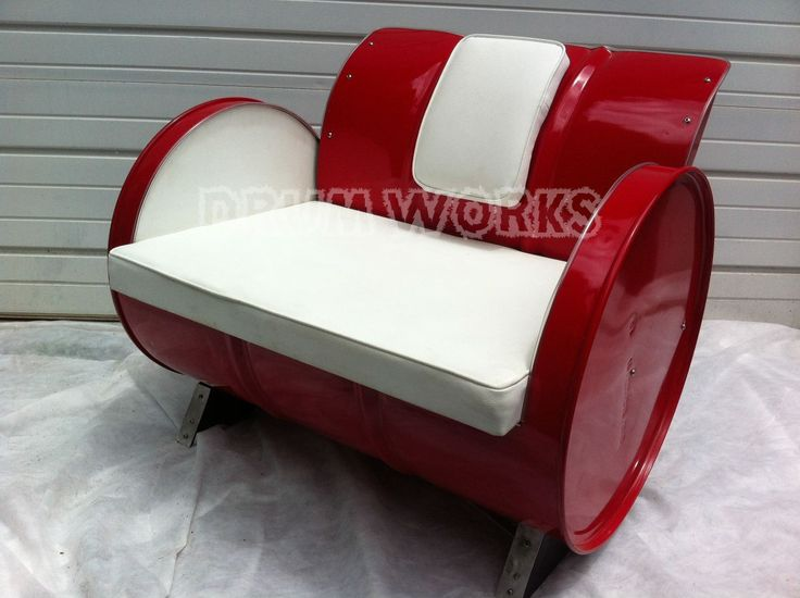 #PCCanadaday Padded steel back style 55 gallon steel drum arm chair with white vinyl upholstery and bright red powder coat finish. www.drumworksfurniture.com