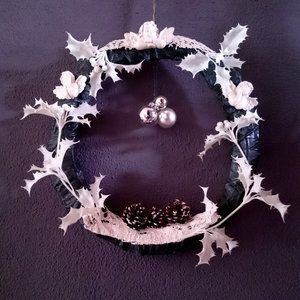 Handmade Christmas wreath decorated with angels and white holly leaves