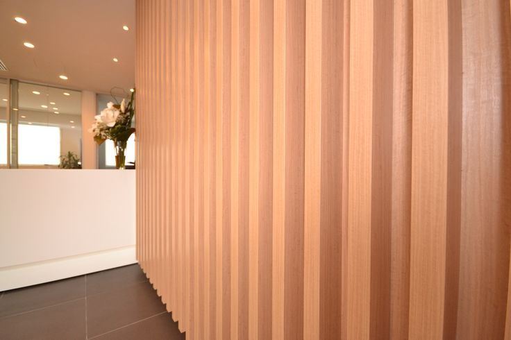 #Navcore 50mm Blockboard lightweight slats in situ for the RCR Partner fitout in Norwood. Designer: Maria Gianquitto Interior Design Installer: A Class Kitchens Decor: New Age Veneers #Navurban Auchen Flower with matching 50mm ABS edging
