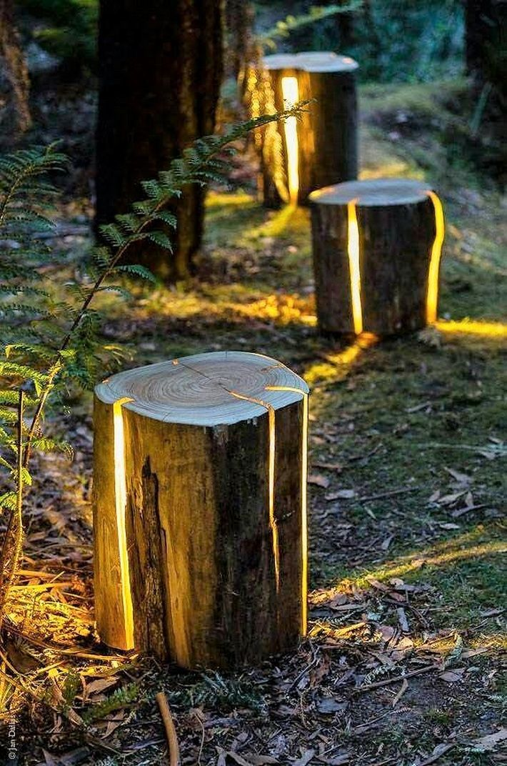 These DIY outdoor wooden log lamps are jaw dropping amazing and stunning, creating a rustic and wild impact in your outdoor. These are perfect for the people who love to innovate with the natural elements. you can scoop out the wood from the log and insert the light bulbs, place them on the pathways in your garden.