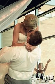 Instead of clinking glasses, different couples come up and introduce them selves and kiss. Then the bride and groom have to re-create that same kiss! Too funny/cute.