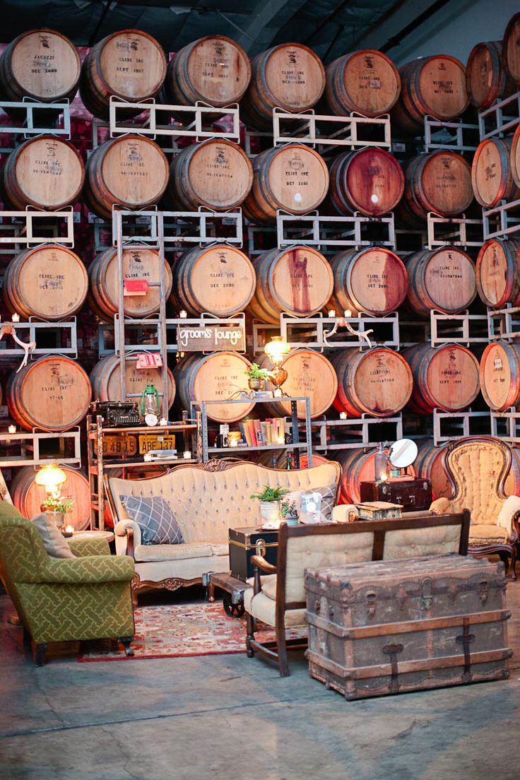 Lounge area surrounded by wine barrels. Sometimes my living room and bedroom feels like this especially when Drew has something going and is bottling one that just got done. It's a good problem to have.